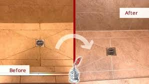 shower grout sealer before and after of this dirty natural stone shower that was totally renewed shower grout