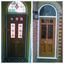 glass outside doors inside and outside of another stunning front door fully bespoke with arched overhead