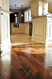 Tile Flooring In Kitchen Hardwood And Tile Floor In Residential Home Kitchen And Dining
