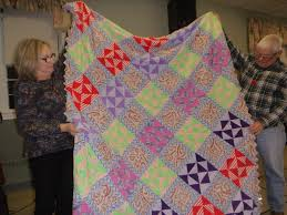 Elm City Quilters' Guild: November Meeting & This quilt shown by Marian has fabric of all different colours and fabric  content, Most likely made from old clothing. There is polyester Adamdwight.com