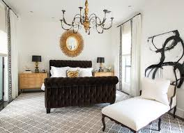 black upholstered sleigh bed. Chic Bedroom Features A Gold Oval Sunburst Mirror Hanging Over Brown Velvet Tufted Sleigh Bed Dressed In White Bedding And Tiger Print Pillow Flanked By Black Upholstered E
