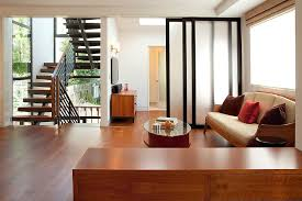 custom doors used as room dividers can be folded away when not needed design