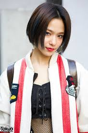 full article for this photo harajuku style icon una w kina fishnet dress troop leather jacket