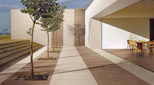 porcelain tiles for external use. this stunning patio with inset trees is tiled porcel-thin ultra thin porcelain tiles. tiles for external use a