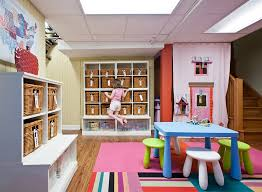 Image Kid Friendly View In Gallery Awesome Basement Playroom With Ample Storage Space Decoist Basement Kids Playroom Ideas And Design Tips