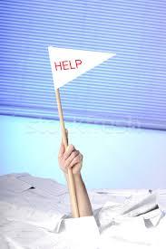 hand help flag sticking out of a desk papers stock photo hand help flag sticking out of a desk papers stock photo acirccopy aldegonde le compte aldegonde 551496 stockfresh