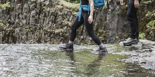 a hiker in hiking boots doing a shallow stream crossing