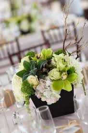 ... Wedding reception centerpiece of green and white flowers with manzanita  branches ...