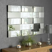 large multi facet frameless wall mirror