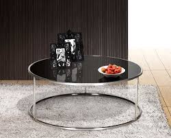 black glass top round cocktail table with stainless steel frame on white rugs for small living
