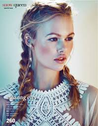 the model wears fishtail braids for the beauty editorial