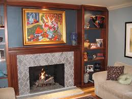 maple mantel and surround bookcases