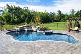 inground pools with waterfalls. Beautiful Waterfalls Lagoon Shaped Inground Pool With Full Black Onyx Liner Rock Waterfall  Jump Rock MultiColoured Lighting Spillover Spa And Thermoplastic Steps With Pools Waterfalls O