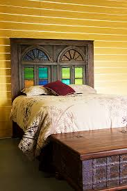 queen headboard created from reclaimed cathedral doors with original  textured and stained glass panels - at