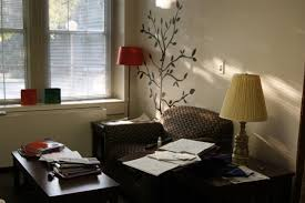 interesting wall decal and table lamp with recliner also window treatment for dorm decor