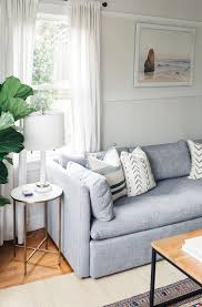 marble living room table. Shelter Sofa And White Marble Side Table Via GG Living Room