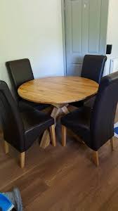 solid oak round table with 4 chairs from next