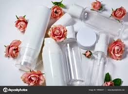 white cosmetic bottles on white background wellness spa and care bottles collection with spring parfume flowers beauty treatment bathroom set