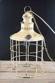 the hanging metal l has a coating of ivory paint with distressed love this for my kitchen