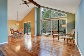 Natural light wood floor Texture Embrace This Rooms Two Distinct And Beautiful Features The Large Windows Which Allow Natural Light To Highlight The Rooms Shiny Hardwood Floors Gulf Tile 30 Living Rooms With Hardwood Floors pictures