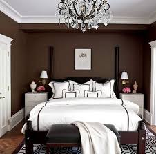 Bedroom. Brown Wooden Bed With White Bed Sheet Plus Black Bench On The Brown  White