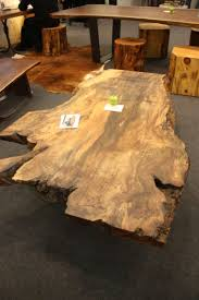 Tree slab coffee table Round Unfinished Wood Slab Coffee Table Homedit Wood Coffee Table From Minimalist To Wonderfully Intricate