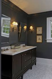 amazing bathroom with dark gray walls accented with dark gray crown moldings framing chocolate brown double vanity with white marble countertop and brown dark gray