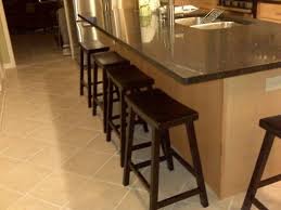 wooden 24 inch counter stools in dark brown on cream ceramics floor plus bar  table for