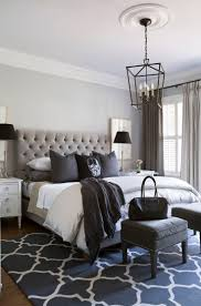 Black, white and every shade in between! Very cool bedroom by Sneller  Custom Homes  minus the skull pillow.