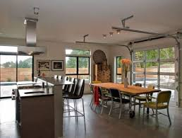 open plan kitchen and dining e with sectioned gl garage doors
