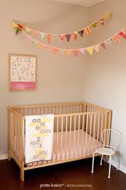 Try out this step by step tutorial (with images) from Petite Lemon for  these adorable DIY pennants for a nursery. Love how it hangs over crib.