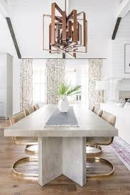 super chic dining living room moment with kelly wearstler curtains design by cortney bi