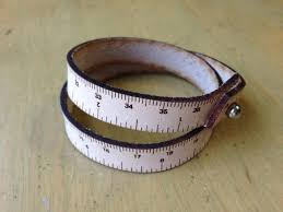 wrist rulers are leather bracelets engraved with inches and centimeters handmade in portland oregon