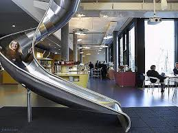 google mumbai office india. google keeps some fun in mind at one of their offices as employees can literally slide from floor down to the next mumbai office india