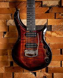 Man tries to review guitar but gets excitement shakes and forgets how to play.music man: The Tiger Eye Majesty Is The Only Ernie Ball Music Man Facebook