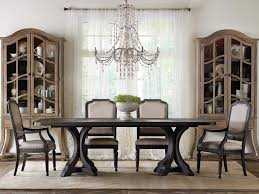 chandeliers are perfect for anchoring a dining room table and add to a timeless dining aesthetic the most important things to consider when hanging a