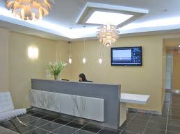 office reception designs. Pale Yellow Wall Color With Adorable Chandelier For Luxury Office Reception Area Design Ideas Grey Colored Desk Designs A