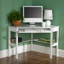 furniture white wooden corner computer desk with sliding keyboard rack and shelf on laminate flooring