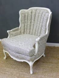 Reupholstered antique channel back arm chair