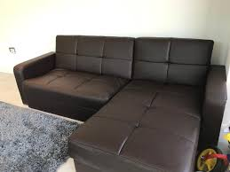 good condition brown faux leather corner sofa bed