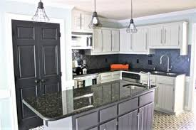 Kitchens with dark painted cabinets Cabinets Ideas Painted Kitchen Cabinets Light And Dark The Spruce Painted Kitchen Cabinet Ideas