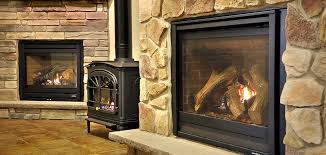 a wood burning fireplace may look beautiful in a family room or living room but there is not much reward for the trouble it takes to cut wood
