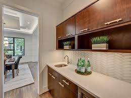 backsplash style white wainscoting storage cabinet with glass door beige granite countertop colorful ceramic floor gas