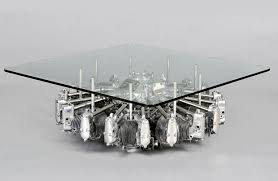 the table is hand crafted from a rare wwii navy practice and a b 52 jet engine turbine fan and it