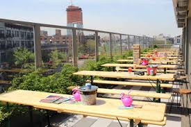 up high the clinton hall rooftop beer garden on the fourth floor of the pod hotel in williamsburg offers lobster rolls beer and enough picnic tables