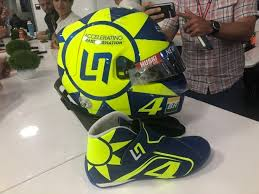 This valentino rossi helmet is a rare piece of memorabilia signed personally by the racing legend. Formula 1 Norris Racing With Valentino Rossi Inspired Helmet