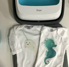 use cricut s new iron on designs to make a diy baby shower gift that only takes
