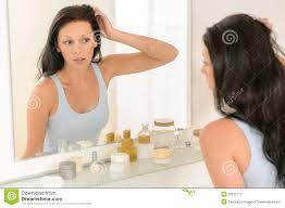 bathroom mirror reflection. Woman Look At Herself Bathroom Mirror Reflection A