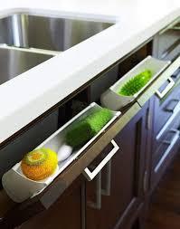 under kitchen sink storage use pull out panel below kitchen sink to sponges