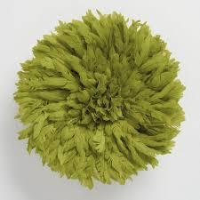 small green juju hat wall hanging